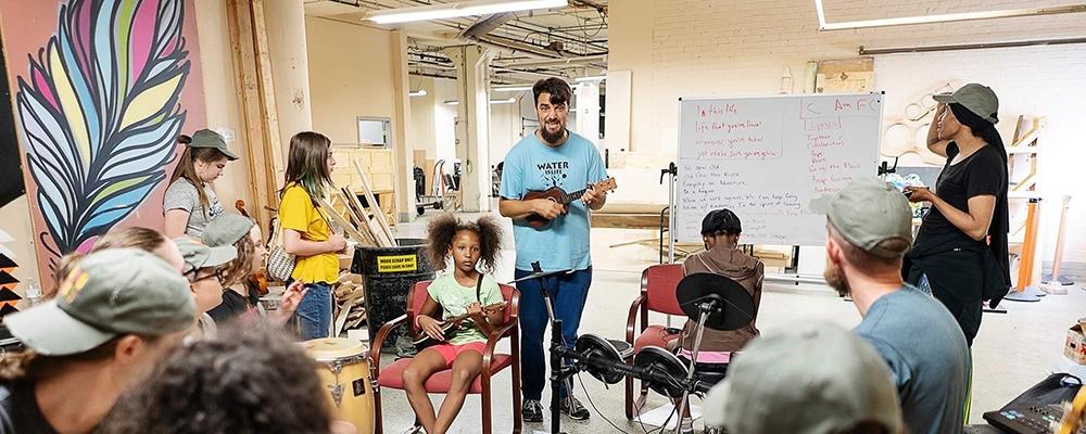 Seth Bernard in a classromm teaching empowerment through music